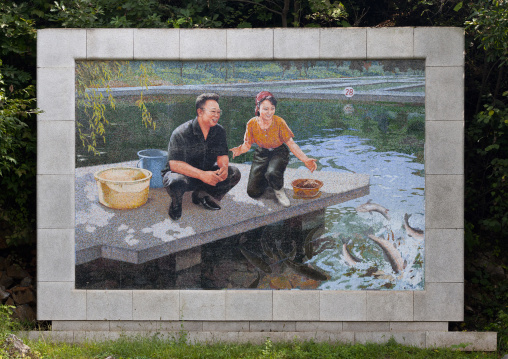 Farm fish mosaic fresco with Kim Jong il and a female worker in front of a pound, North Hwanghae Province, Sariwon, North Korea