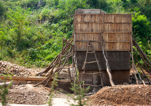 Construction of anti tank invasion concrete blocks on roadside, North Hwanghae Province, Sariwon, North Korea
