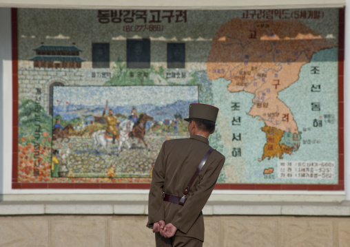 North Korean soldier looking at a Korea map in the street, North Hwanghae Province, Sariwon, North Korea