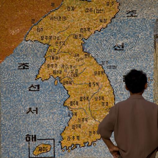 North Korean man looking a Korea map in the street, North Hwanghae Province, Sariwon, North Korea