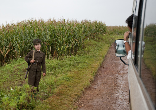A bus driver speaks to a North Korean soldier in the countryside, North Hwanghae Province, Kaesong, North Korea