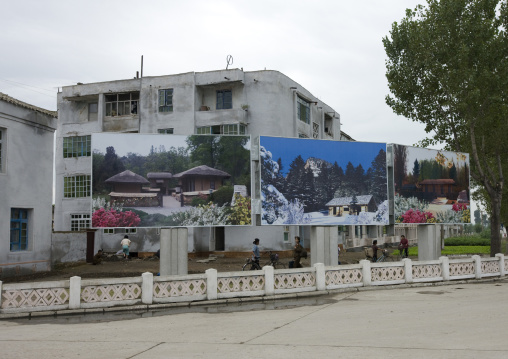 Pictures of the native houses the Dear Leaders on a propaganda billboard, North Hwanghae Province, Kaesong, North Korea