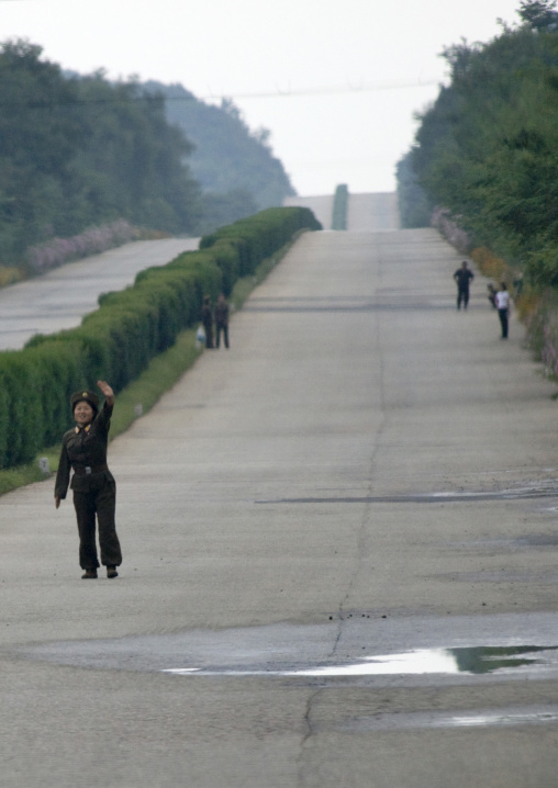 North Korean soldier trying to stop a bus on a highway, North Hwanghae Province, Kaesong, North Korea