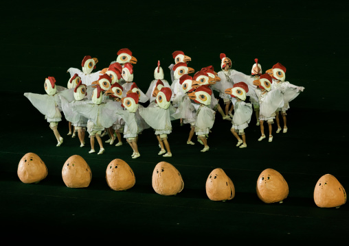 North Korean people dressed as chickens in front of giant eggs during the Arirang mass games in may day stadium, Pyongan Province, Pyongyang, North Korea