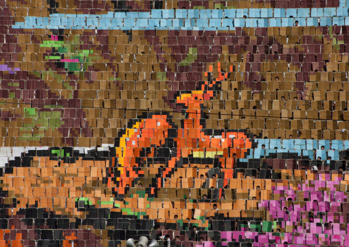 Deers made by human pixels holding up colored boards during Arirang mass games in may day stadium, Pyongan Province, Pyongyang, North Korea