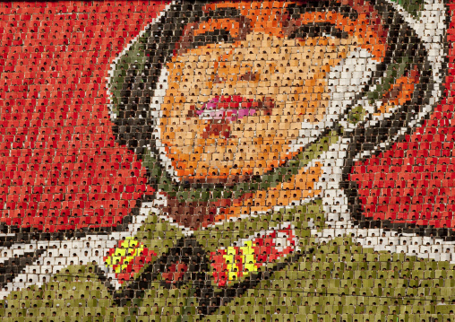 North Korean soldier made by children pixels holding up colored boards during Arirang mass games in may day stadium, Pyongan Province, Pyongyang, North Korea