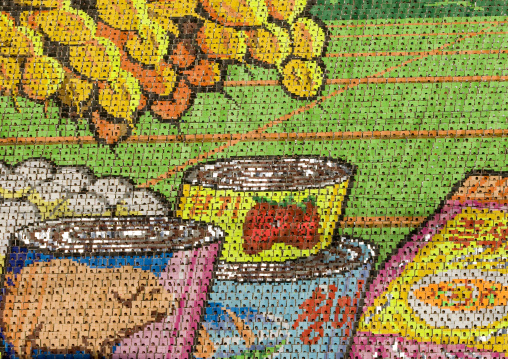 Food cans made by children pixels holding up colored boards during Arirang mass games in may day stadium, Pyongan Province, Pyongyang, North Korea