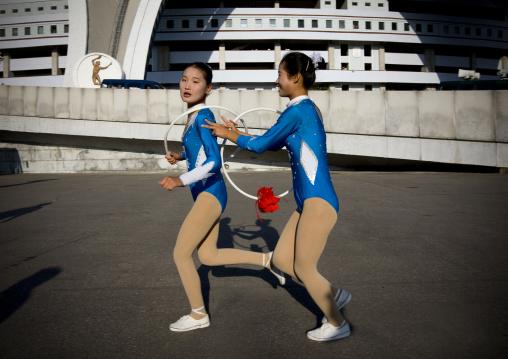North Korean gymnasts going to the Arirang mass games outside of may day stadium, Pyongan Province, Pyongyang, North Korea