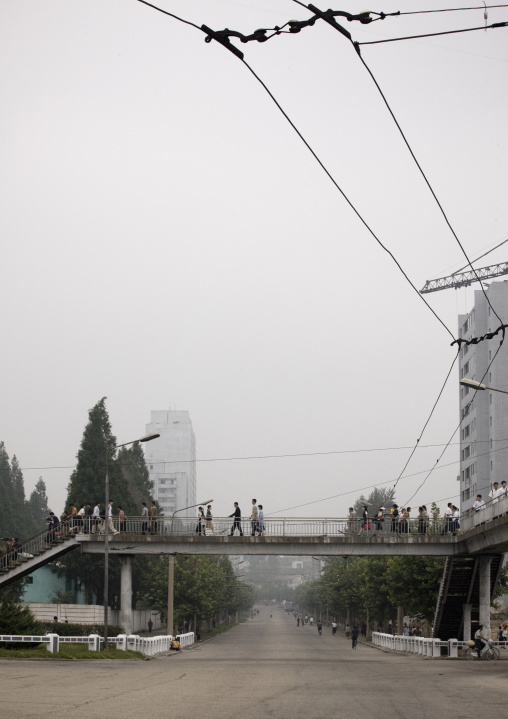 North Korean people crossing a bridge in town, Pyongan Province, Pyongyang, North Korea