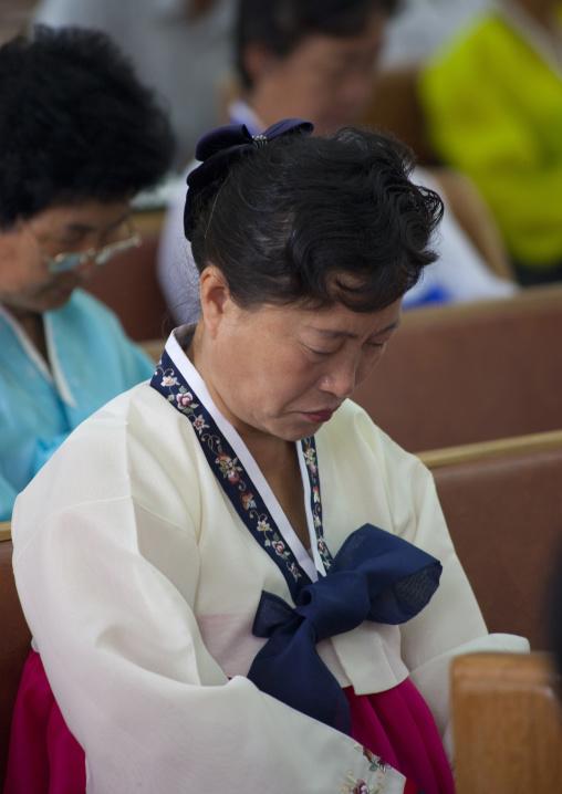 North Korean woman during a mass in protestant Bongsu church, Pyongan Province, Pyongyang, North Korea