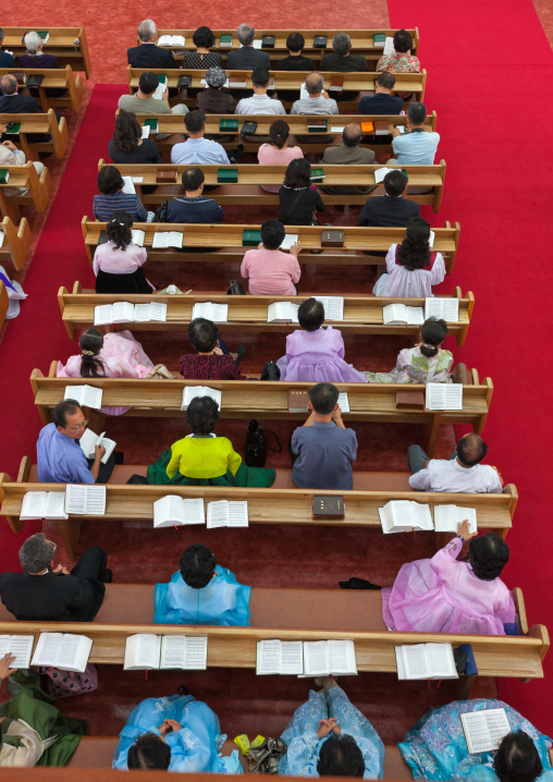 North Korean worshiper reading the bible during a sunday mass in protestant Bongsu church, Pyongan Province, Pyongyang, North Korea
