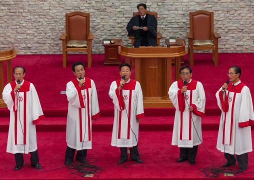 North Korean men singing in protestant Bongsu church, Pyongan Province, Pyongyang, North Korea