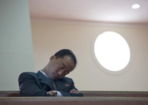 North Korean official sleeping in protestant Bongsu church, Pyongan Province, Pyongyang, North Korea
