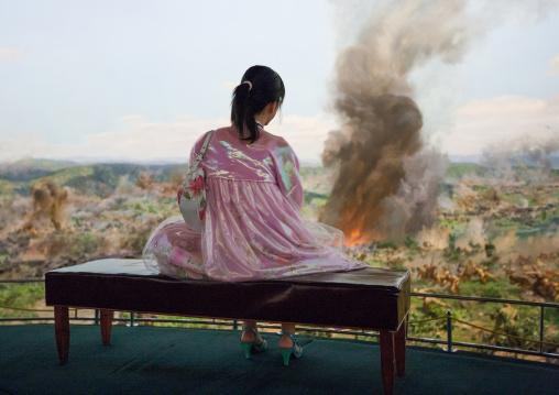North Korean visitor lookingthe battle of taejon diorama in the victorious fatherland liberation war museum, Pyongan Province, Pyongyang, North Korea