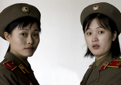 North Korean museum guides in the victorious fatherland liberation war museum, Pyongan Province, Pyongyang, North Korea