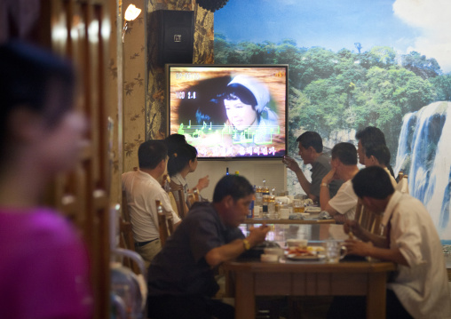 North Korean people in a luxury restaurant in front of a karaoke television, Pyongan Province, Pyongyang, North Korea