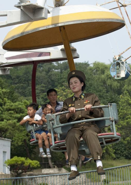 North Korean soldier on an attraction in Taesongsan funfair, Pyongan Province, Pyongyang, North Korea