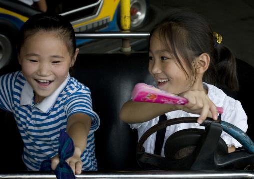 North Korean girls in bumpers cars in Taesongsan funfair, Pyongan Province, Pyongyang, North Korea