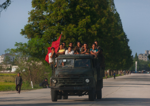 North Korean workers with a red flag at the back of a truck, North Hamgyong Province, Chilbo Sea, North Korea