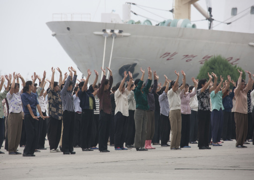 Women raising hands during morning exercise session, Kangwon Province, Wonsan, North Korea