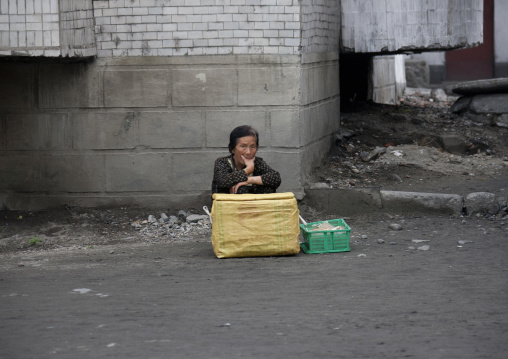 North Korean woman selling ice creams in the street, Kangwon Province, Wonsan, North Korea