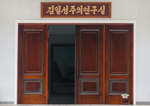 Phone on a small table at the entrance of an office of studies, South Hamgyong Province, Hamhung, North Korea