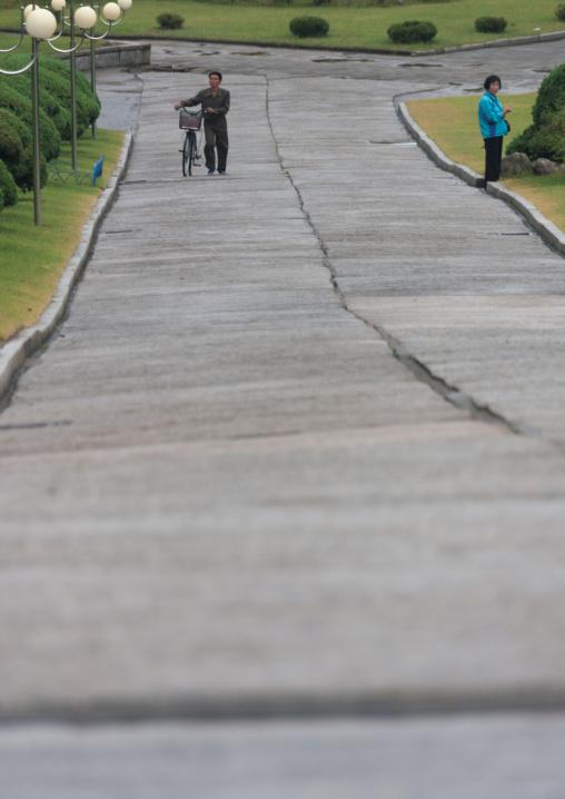 North Korean people on an empty road, South Hamgyong Province, Hamhung, North Korea