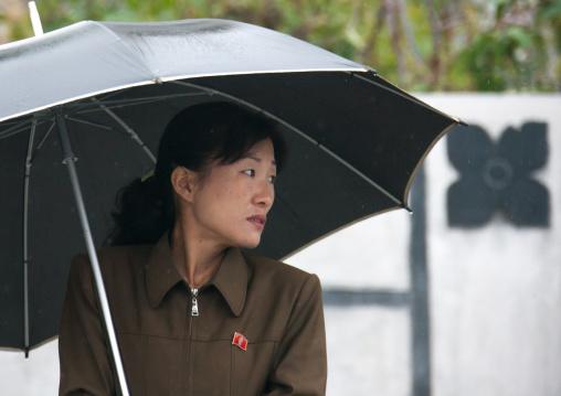 Portrait of a North Korean woman with an umbrella under the rain, South Hamgyong Province, Hamhung, North Korea