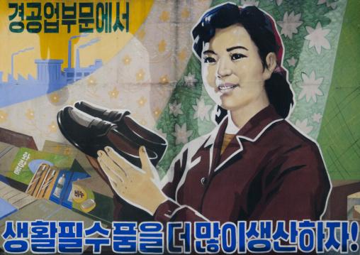 Advertisement of a North Korean woman holding shoes, South Hamgyong Province, Hamhung, North Korea