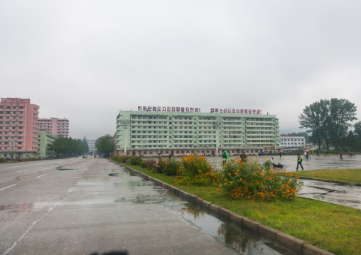 Building with a propaganda slogan on the top in the countryside, South Hamgyong Province, Hamhung, North Korea