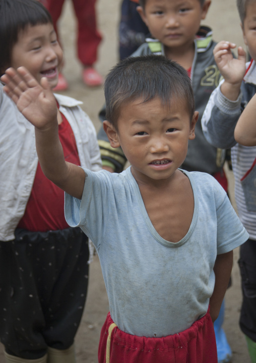 North Korean skinny boy raising hand in a school, South Hamgyong Province, Hamhung, North Korea