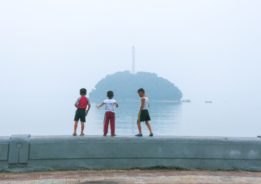 North Korean children in front of a little island, South Hamgyong Province, Hamhung, North Korea