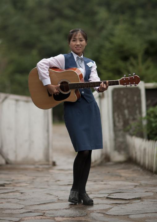 North Korean woman playing guitar, North Hamgyong Province, Jung Pyong Ri, North Korea