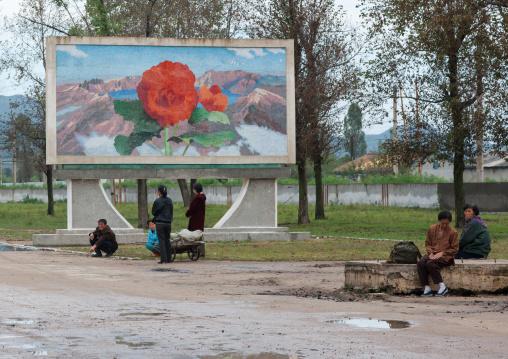 North Korean propaganda billboard depicting a Kimilsungia flower on mount Paektu, North Hamgyong Province, Jung Pyong Ri, North Korea