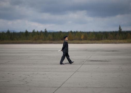 North Korean employee walking on runway Samjiyon airport, Ryanggang Province, Samjiyon, North Korea