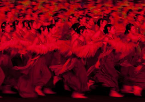 North Korean women dancing in choson-ot during the Arirang mass games in may day stadium, Pyongan Province, Pyongyang, North Korea