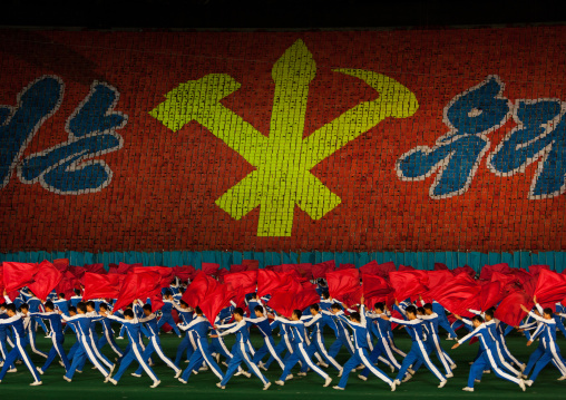 Workers' Party logo made by children pixels holding up colored boards during Arirang mass games in may day stadium, Pyongan Province, Pyongyang, North Korea