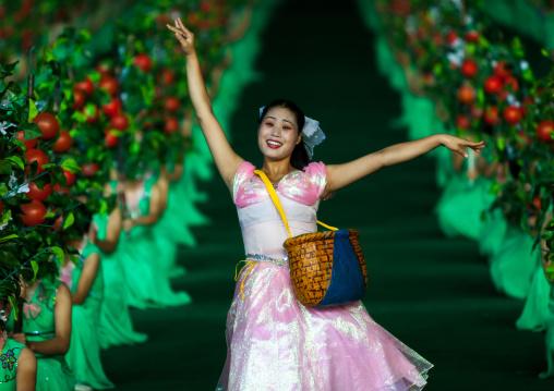 North Korean women dancing between apples during the Arirang mass games in may day stadium, Pyongan Province, Pyongyang, North Korea