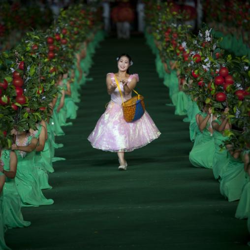 Women dancing between apples at Arirang mass games in may day stadium, Pyongan Province, Pyongyang, North Korea