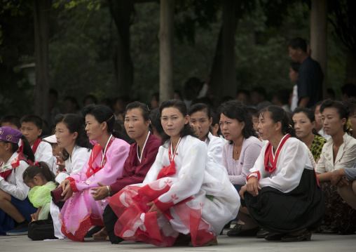 North Korean people squatting and waiting to visit the Kim il Sung Mangyongdae native house, Pyongan Province, Pyongyang, North Korea