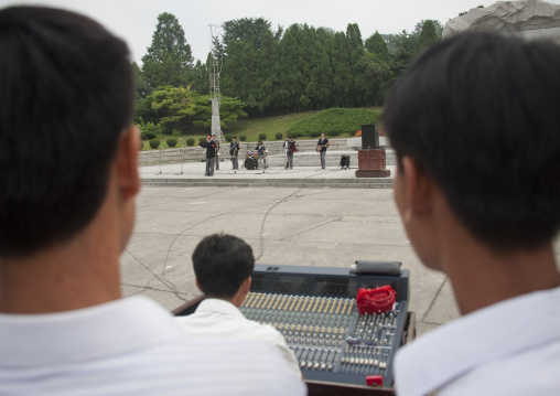 North Korean people listening to a band playing music on national day in the street, Pyongan Province, Pyongyang, North Korea