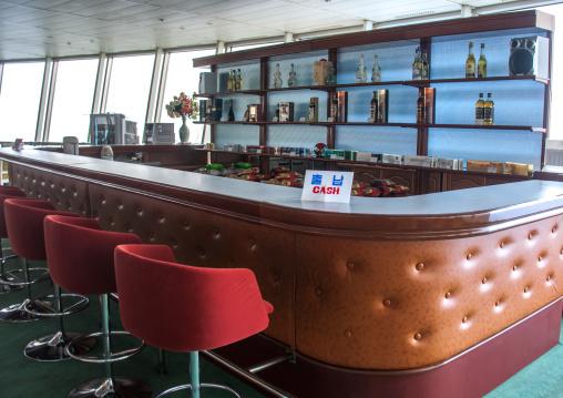 Empty bar in Yanggakdo international hotel with a cash billboard, Pyongan Province, Pyongyang, North Korea