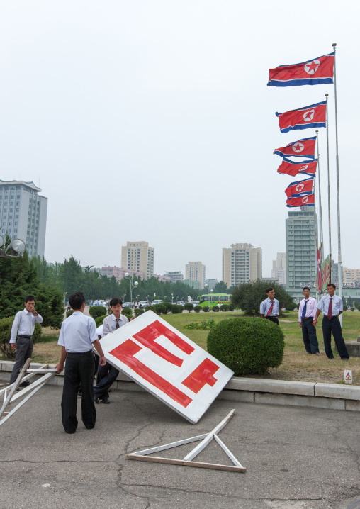 Propaganda billboards during a mass dance performance on september 9 day of the foundation of the republic, Pyongan Province, Pyongyang, North Korea