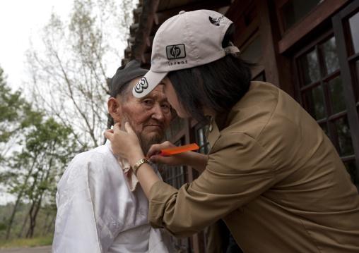 Old actor make-up during a movie shooting in Pyongyang film studios, Pyongan Province, Pyongyang, North Korea