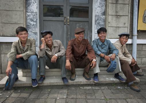 North Korean actors sitting on steps at Pyongyang film studio, Pyongan Province, Pyongyang, North Korea