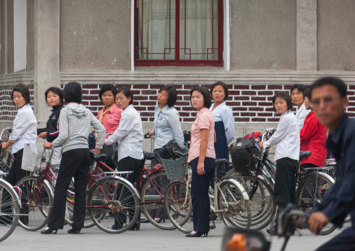 North Korean women going to work with bicycles, North Hwanghae Province, Kaesong, North Korea