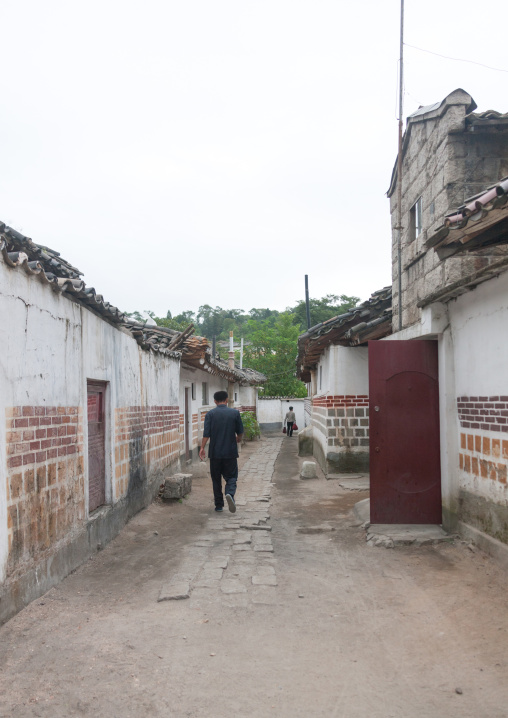 North Korean man passing through a street of the old town, North Hwanghae Province, Kaesong, North Korea