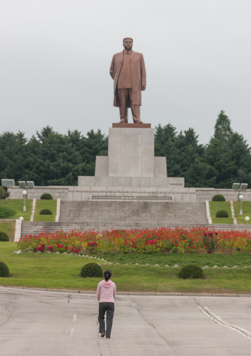 North Korean girl in front of Dear leader Kim il Sung statue, North Hwanghae Province, Kaesong, North Korea