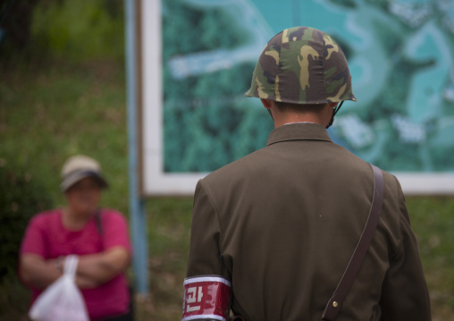 North Korean soldier with a tourist in the Demilitarized Zone, North Hwanghae Province, Panmunjom, North Korea