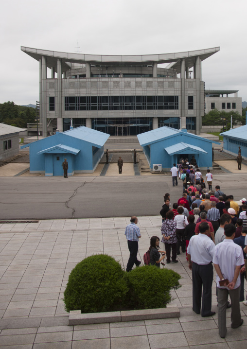 Tourists queueing to visit the conference room on the Demilitarized Zone, North Hwanghae Province, Panmunjom, North Korea